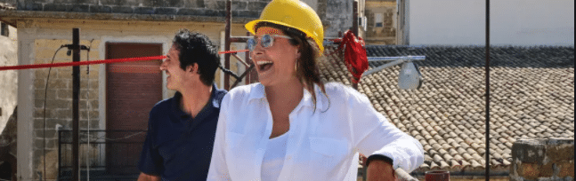 Goodfellas and Sopranos Actress Lorraine Bracco Laughing and Wearing A Construction Hard Hat On Site Of Her Italian Home Renovation