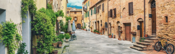 Picture of A Quaint Italian Street With Plants And A Bicycle With Homes For Sale For 1 Euro
