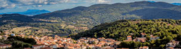 Picture of A Sunny Day Depicting Rolling Hills And A Small Town In The Italian Countryside
