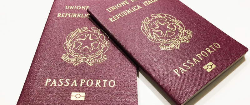 Two Italian passports laid on top of each other