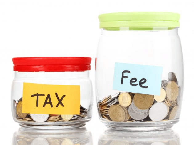 Two jars with money side by side with post-its reading 'tax' on the left one and 'fee' on the right one