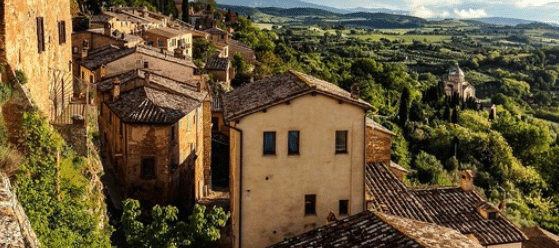 Yellow-Brick Italian Houses On A Steep Slope In The Countryside